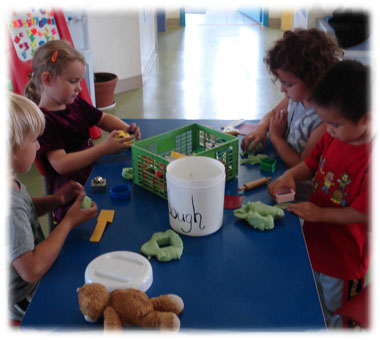 Daycare children creating with playdough - what fun!